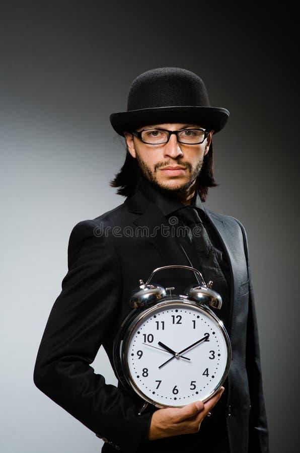 Mężczyzna z zegarowy być ubranym obrazy royalty free