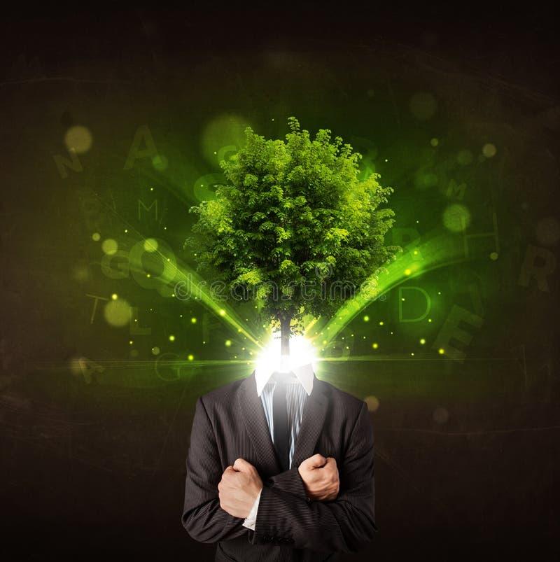 Mężczyzna z zielonym drzewo głowy pojęciem obrazy royalty free