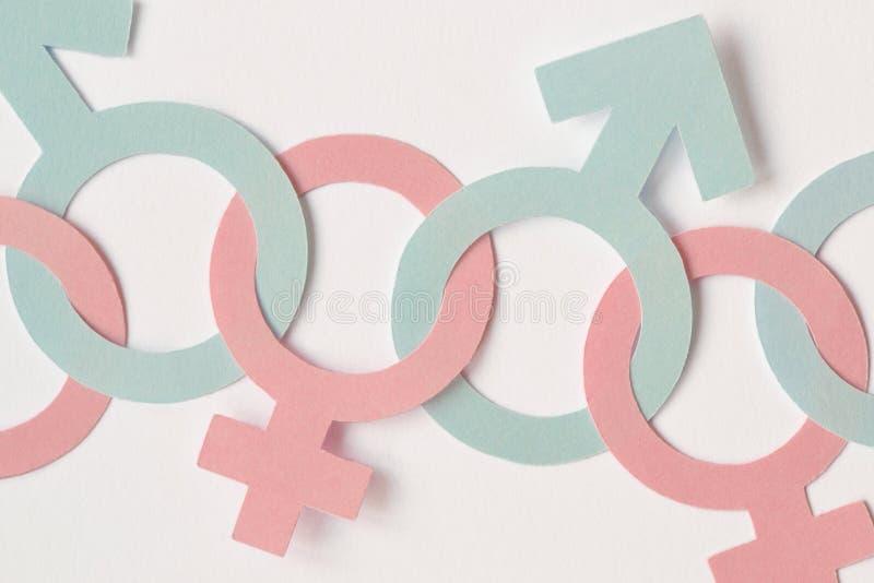 Męscy i żeńscy rodzajów symbole przykuwali wpólnie - rodzaju relatio zdjęcia stock