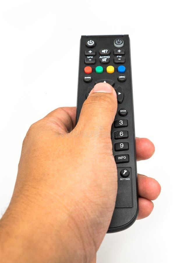 Męska ręka trzyma TV pilot do tv zdjęcie stock