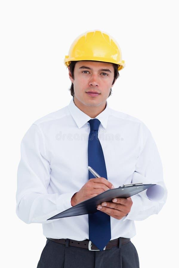 Męski architekt z schowkiem i piórem zdjęcie stock