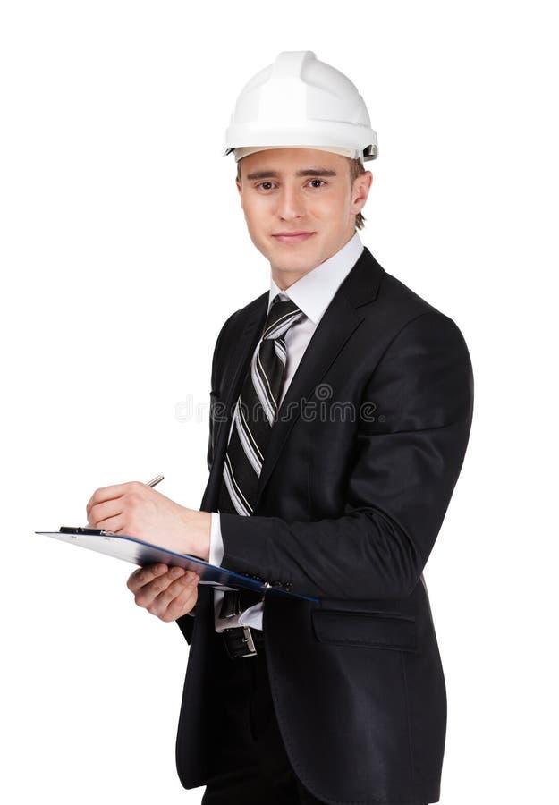 Męski budowniczy w headpiece z papierami fotografia stock