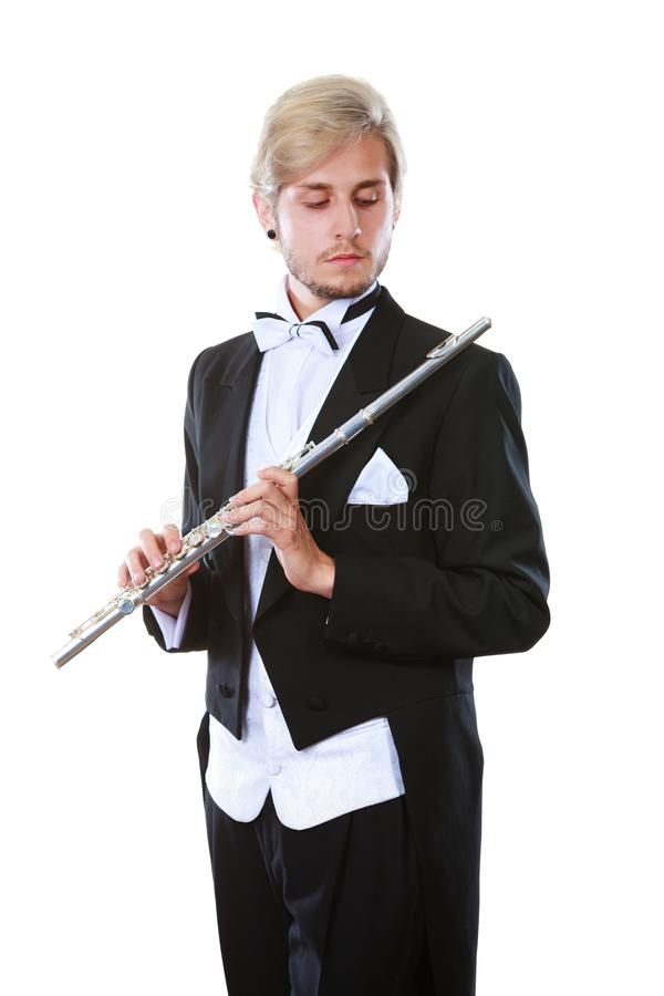 Męski flecista jest ubranym tailcoat chwytów flet fotografia royalty free
