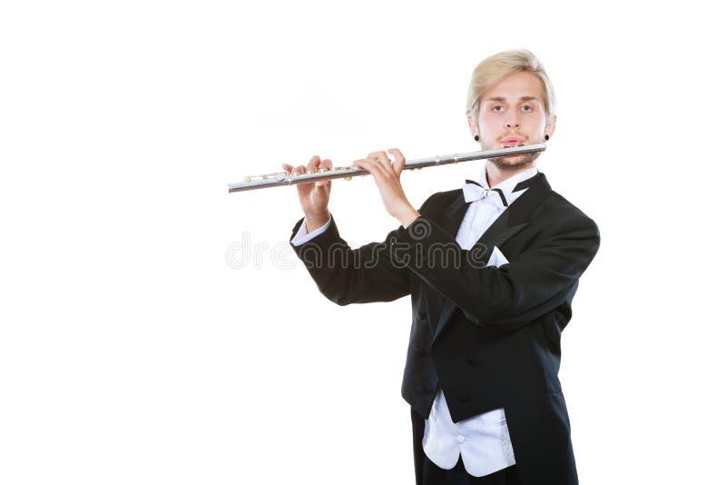 Męski flecista jest ubranym tailcoat sztuk flet zdjęcia stock