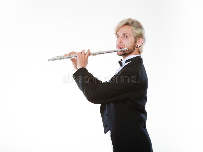 Męski flecista jest ubranym tailcoat sztuk flet fotografia royalty free