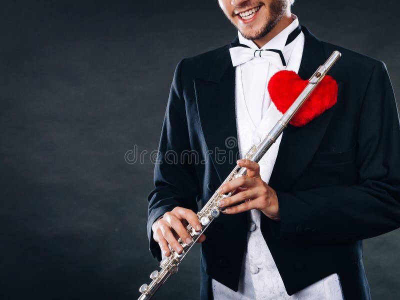 Męski flecista z fletem i sercem Miłości melodia fotografia royalty free