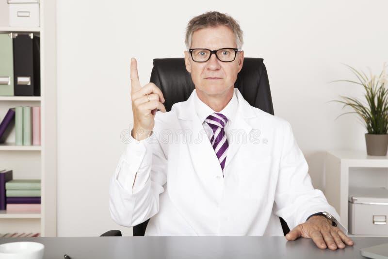 Męski lekarz Pokazuje Najpierw - ręka znaka fotografia royalty free