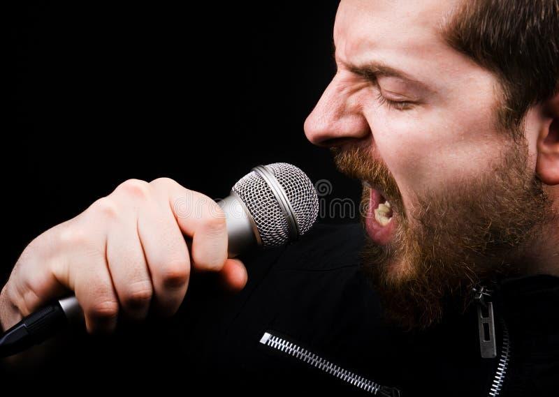 męski muzyczny rockowy piosenkarz zdjęcie royalty free