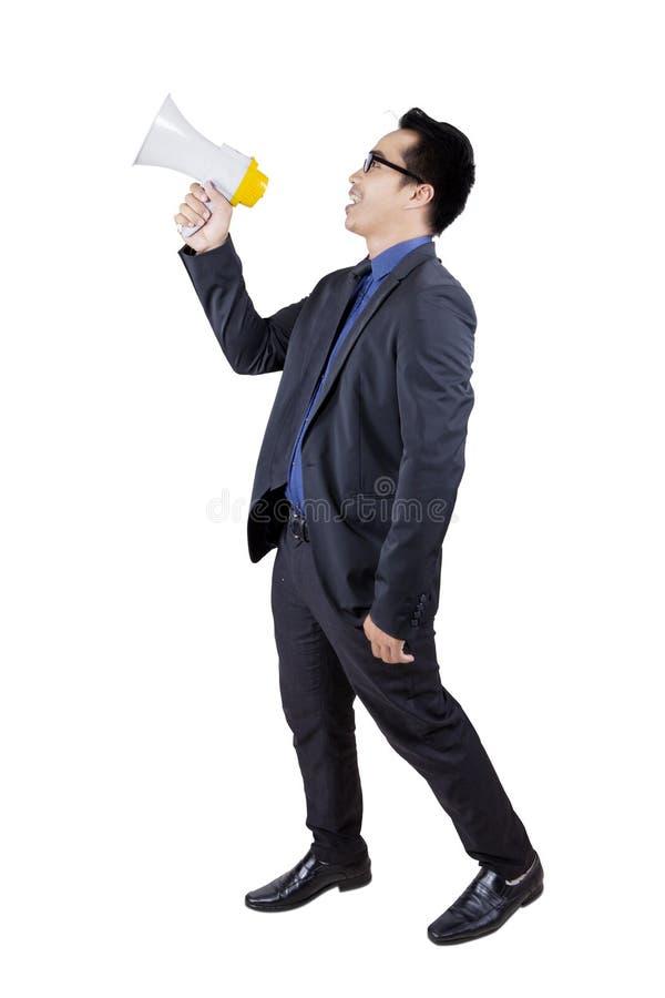 Męski pracownik opowiada z megafonem fotografia royalty free
