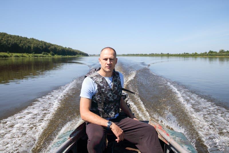 Męski rybak na łodzi zdjęcie royalty free