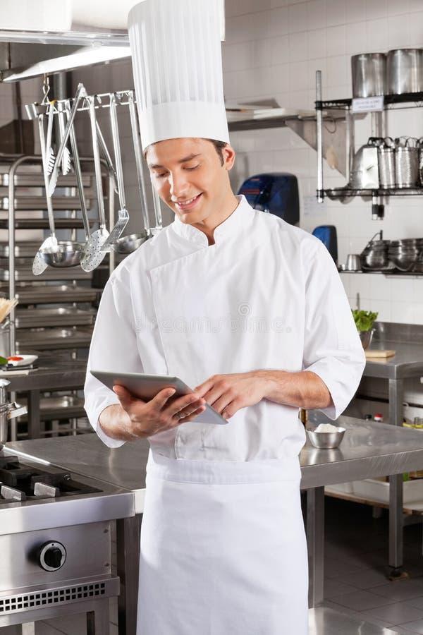 Męski szef kuchni Używa Digital obrazy royalty free