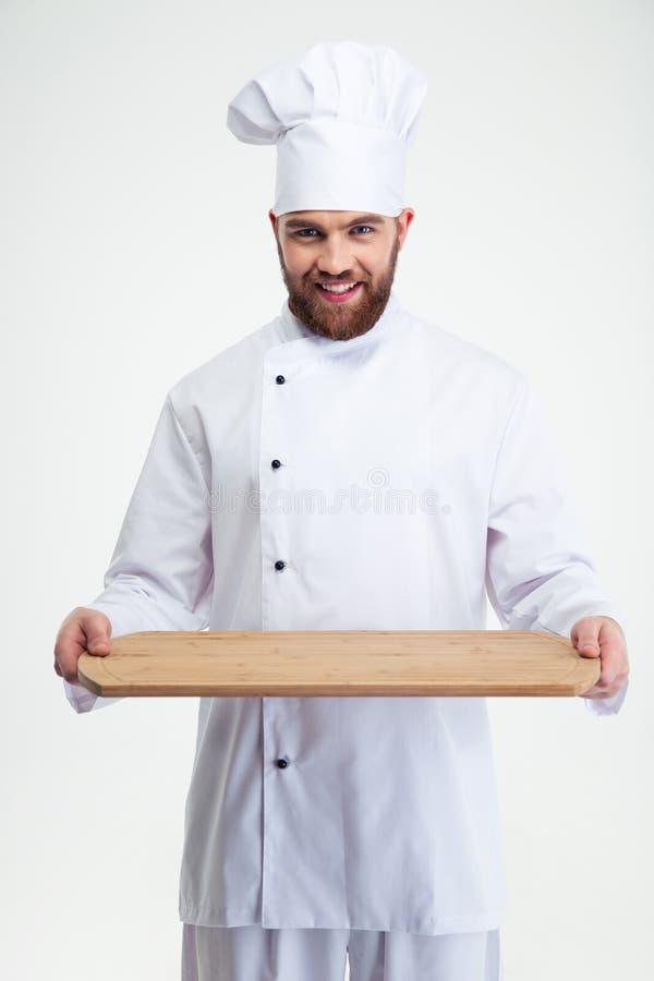 Męski szefa kuchni kucharz trzyma drewnianą ciapanie deskę obrazy royalty free
