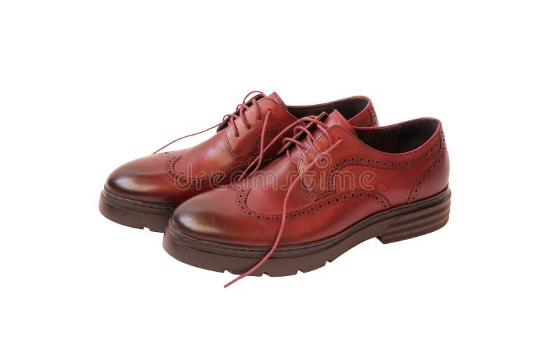 Męskiego brązu rzemienni buty odizolowywający na bielu Selekcyjna ostro?? fotografia stock