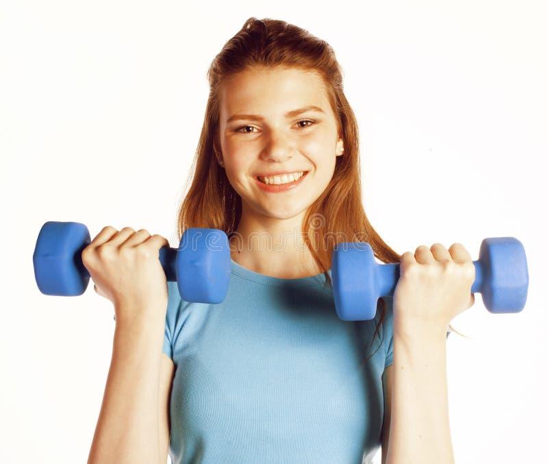 Młoda ładna szczupła kobieta z dumbbell odizolowywał rozochocony ono uśmiecha się, istny dziewczyny w przyległym budynku fotografia stock