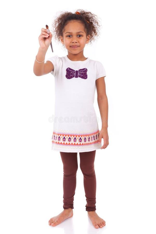 Młoda afrykańska azjatykcia dziewczyna trzyma farby muśnięcie zdjęcie royalty free
