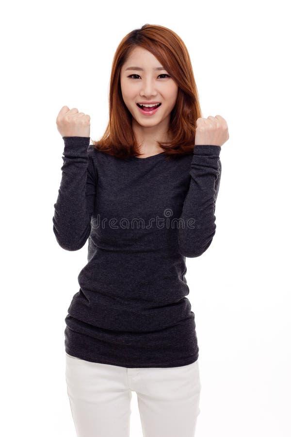 Młoda Azjatycka kobieta zaciskał pięści zdjęcie royalty free