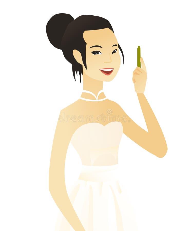 Młoda azjatykcia uśmiechnięta narzeczona z piórem royalty ilustracja