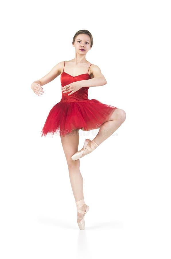 Młoda balerina w czerwonej spódniczce baletnicy obrazy stock