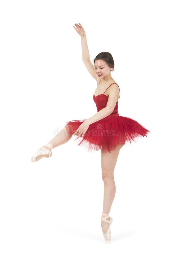 Młoda balerina w czerwonej spódniczce baletnicy zdjęcie royalty free