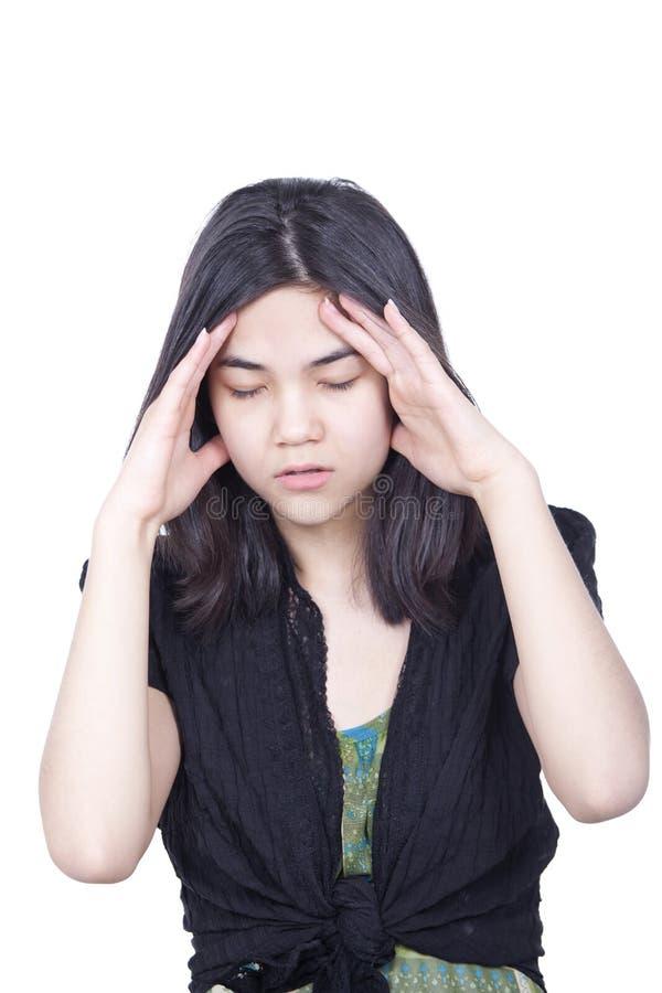 Młoda biracial nastoletnia dziewczyna, stresująca się, migrena zdjęcia stock