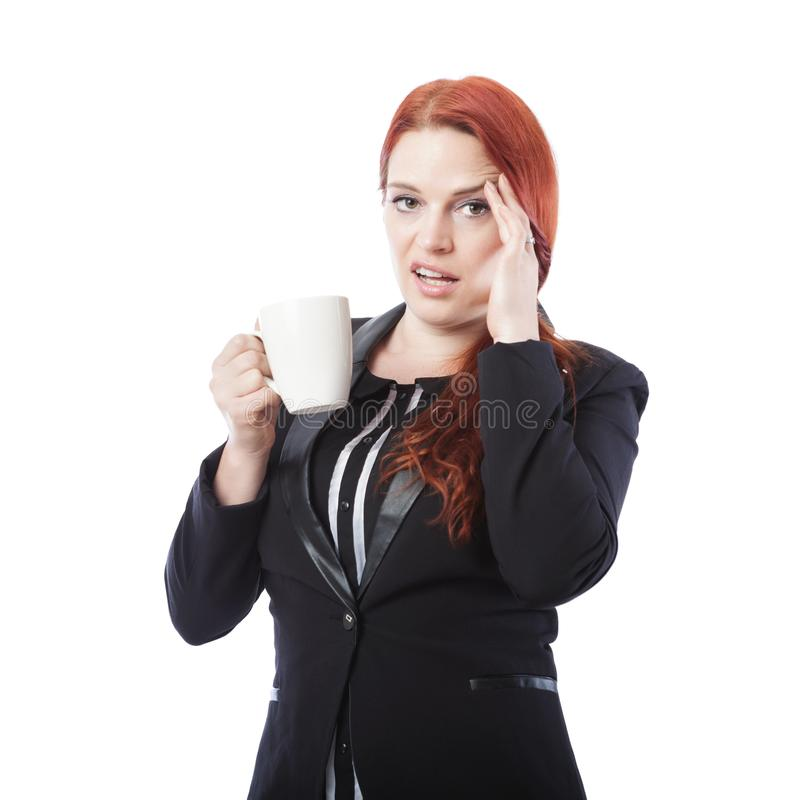 Młoda biznesowa kobieta jest zmęczona z kawą w jej ręce obrazy stock