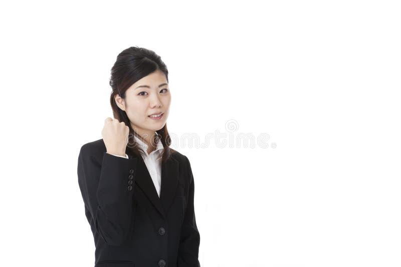Młoda biznesowa kobieta robi żyłki pozie zdjęcia stock