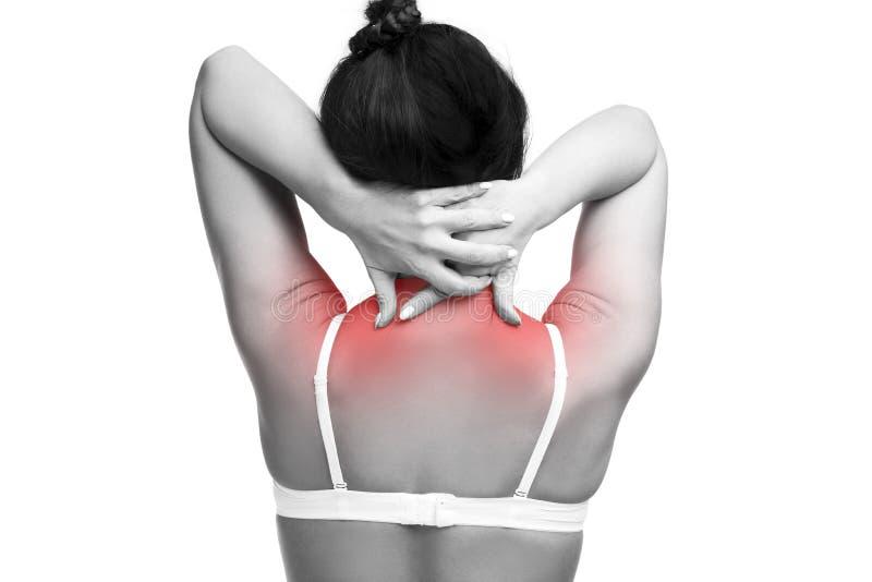 Młoda caucasian kobieta w staniku z bólem w ramionach i szyja, obolałość w ciele ludzkim na białym tle, obrazy stock