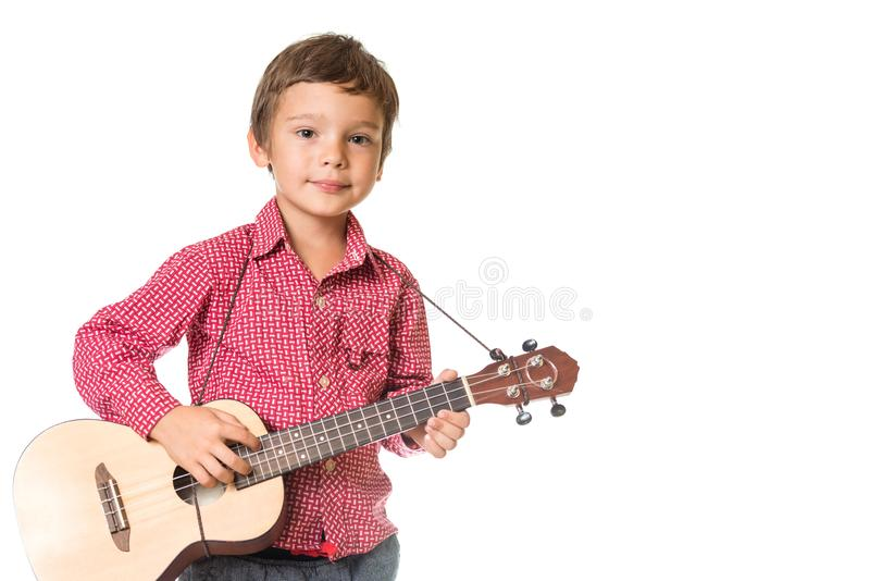 Młoda chłopiec bawić się ukulele obrazy stock