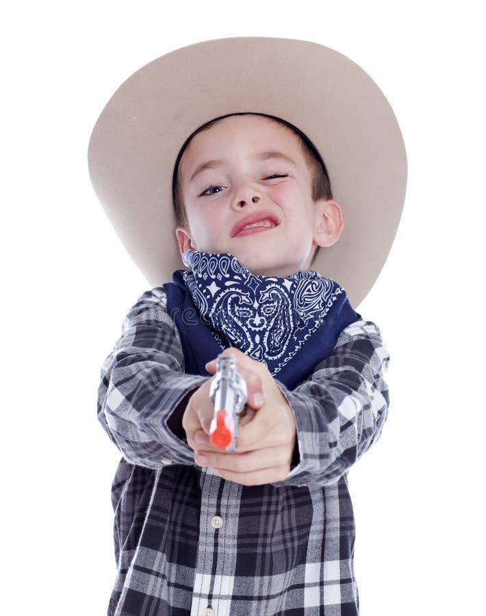 Młoda chłopiec ubierająca jako kowboj fotografia royalty free