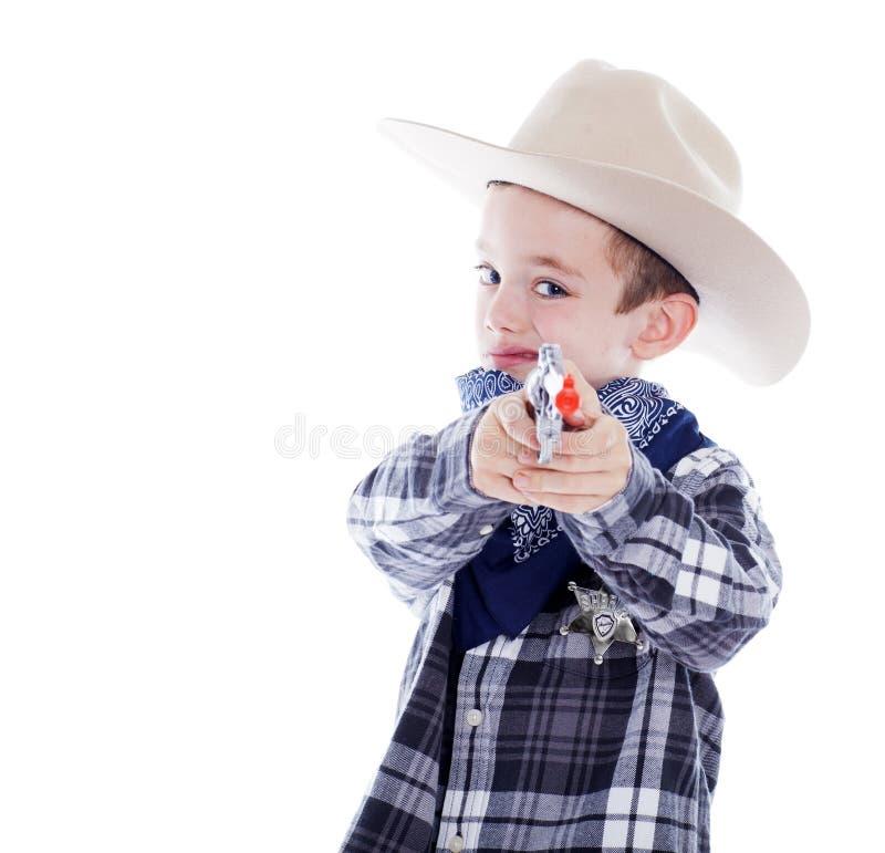 Młoda chłopiec ubierająca jako kowboj zdjęcia stock