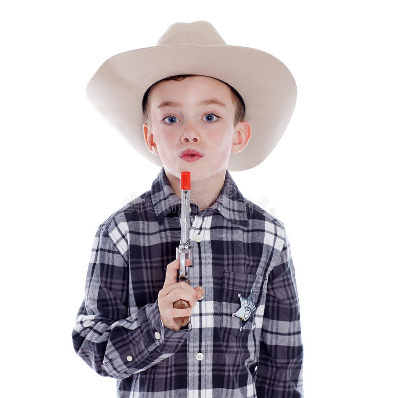 Młoda chłopiec ubierająca jako kowboj zdjęcia royalty free