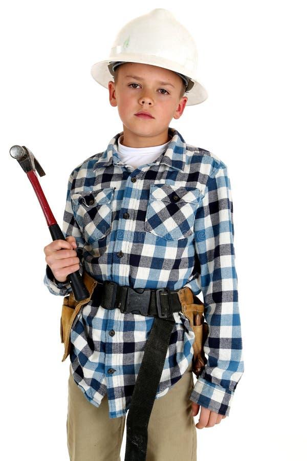 Młoda chłopiec waring budowa pasek i hardhat obraz stock
