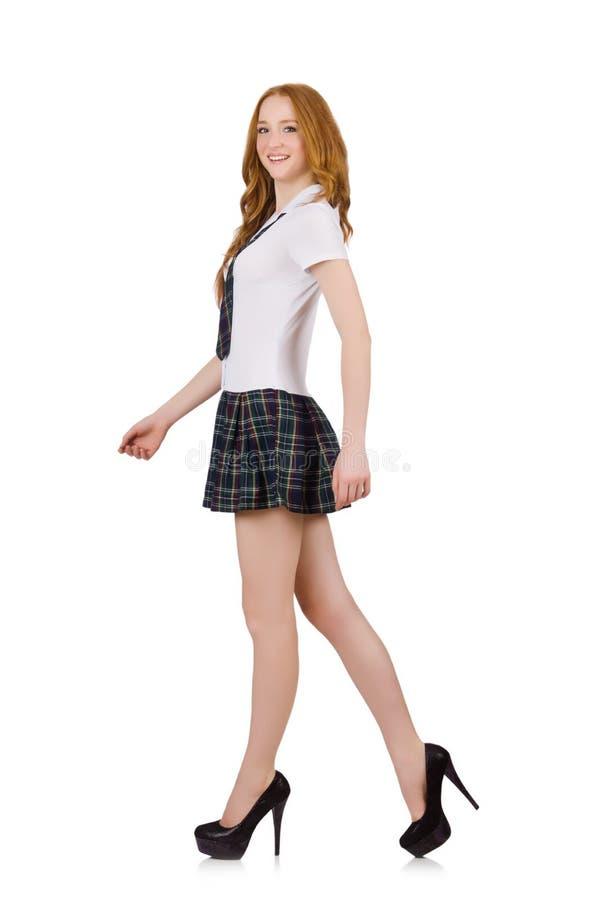Młoda chodząca studencka kobieta odizolowywająca na bielu zdjęcie royalty free