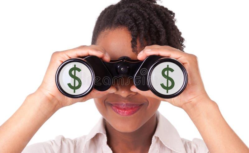 Młoda czerni, amerykanina afrykańskiego pochodzenia biznesowa kobieta używa lornetki/ zdjęcie stock