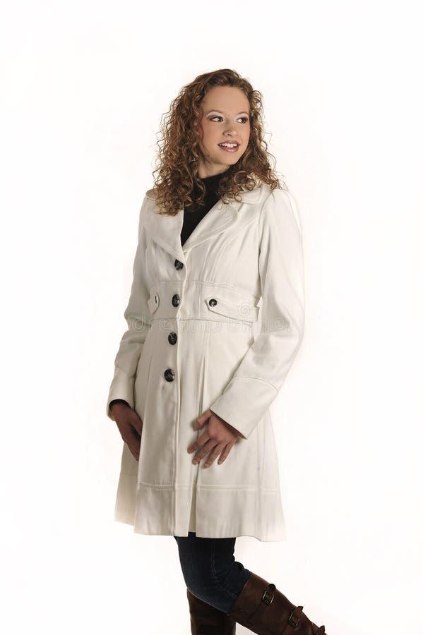 Młoda dama pozująca na biały tle fotografia royalty free