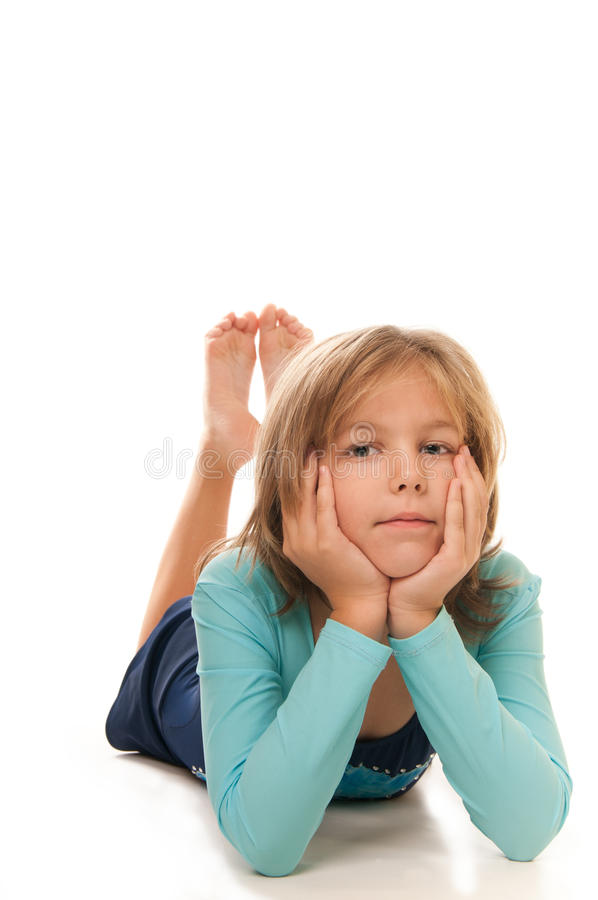 Młoda dziewczyna robi gimnastykom zdjęcia stock
