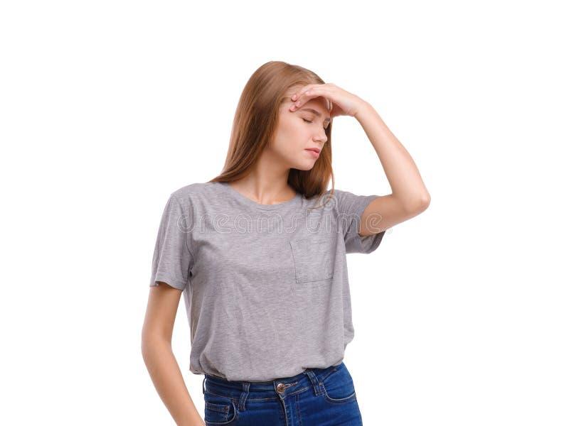 Młoda dziewczyna trzyma dalej przewodzić pokazywać migrenę Odizolowywający na bielu obraz royalty free
