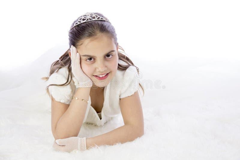 Młoda dziewczyna w jej Pierwszy komuni fotografia royalty free