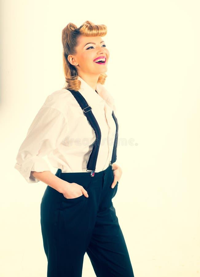 Młoda dziewczyna w spodniach szcz??liwa kobieta kobieta jednostek gospodarczych zdjęcie royalty free