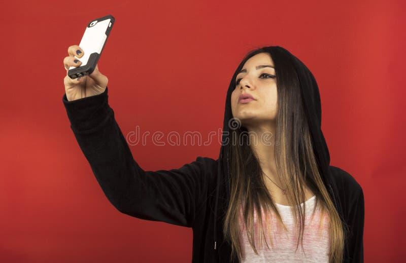 Młoda dziewczyna w studiu zdjęcia stock