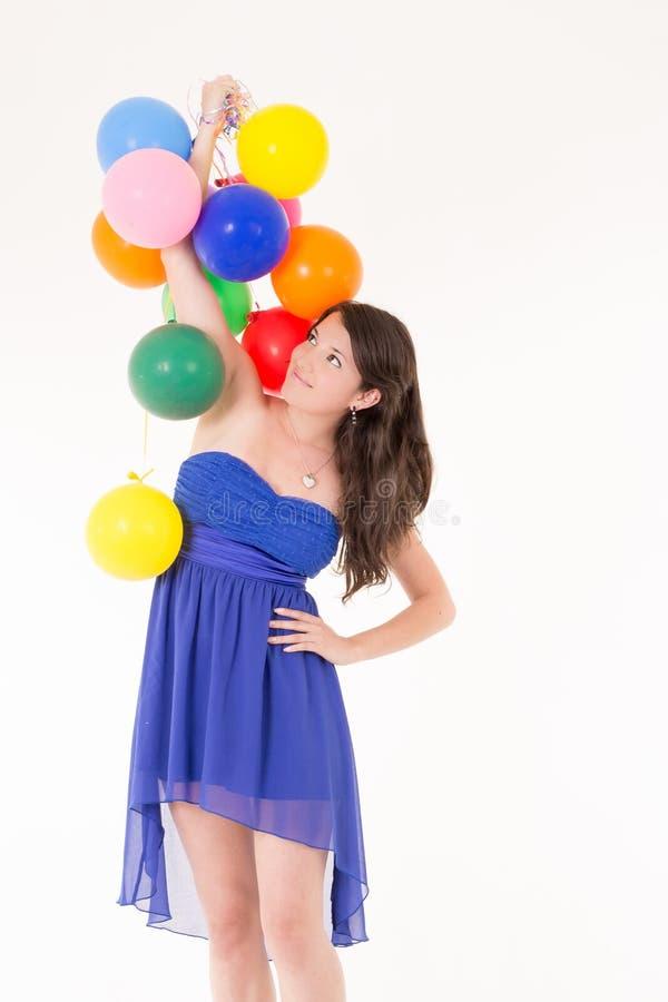 Młoda dziewczyna z balonami na białym tle zdjęcie stock