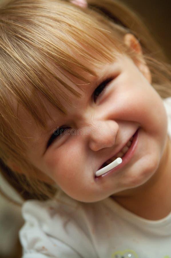 Młoda dziewczyna z lizakiem zdjęcia stock