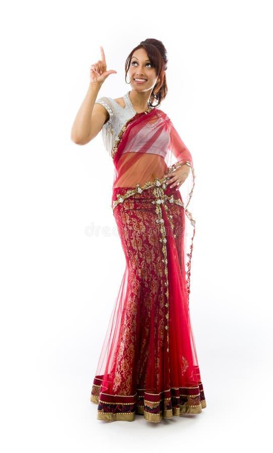 Download Młoda Indiańska Kobieta Wskazuje Upwards Obraz Stock - Obraz złożonej z target44, szczęście: 41951643
