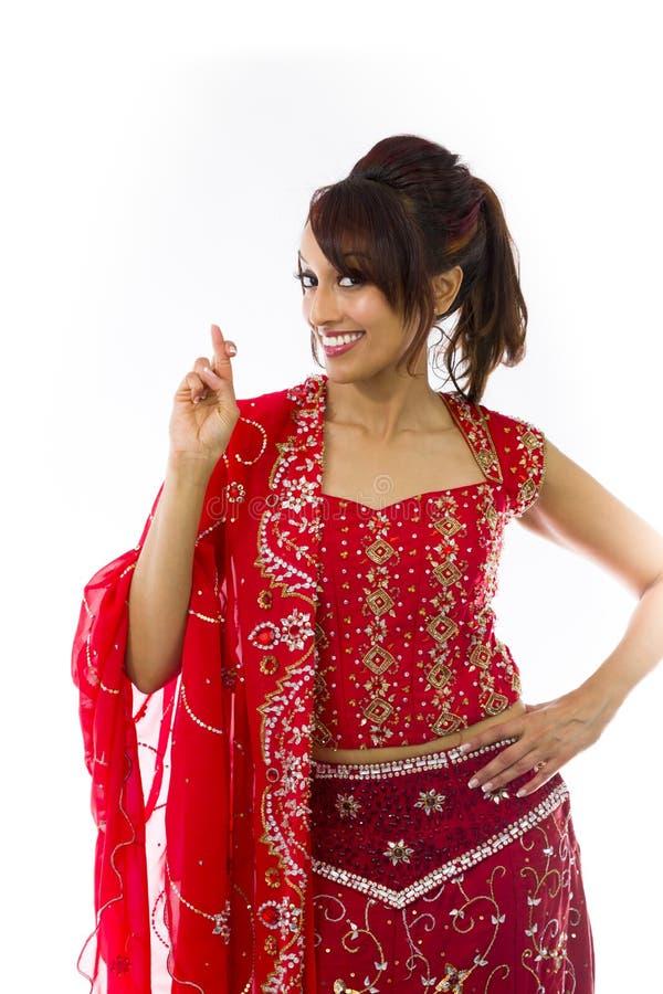 Download Młoda Indiańska Kobiety Pozycja Z Palcem Krzyżującym Zdjęcie Stock - Obraz złożonej z wyrażenie, gesundheit: 41952214