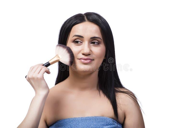 Młoda kobieta dostaje makijaż na bielu obraz stock
