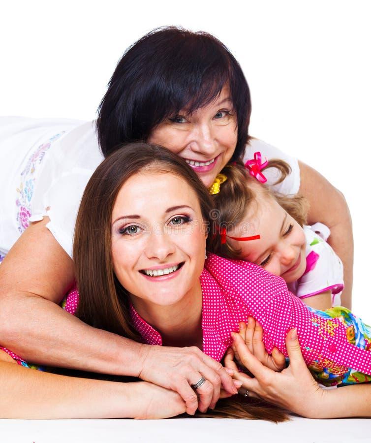 Młoda kobieta, jej matka i córka, zdjęcie royalty free