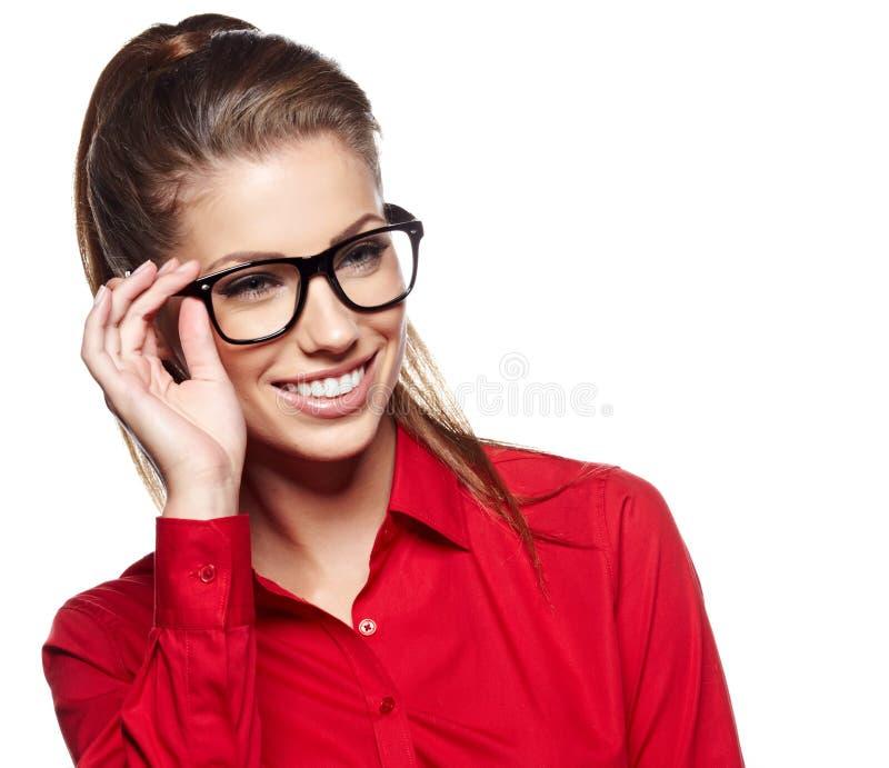 Młoda kobieta jest ubranym szkła zdjęcia royalty free