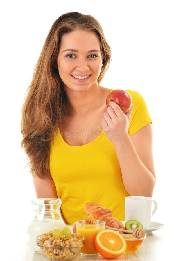 Młoda kobieta ma śniadanie obrazy stock