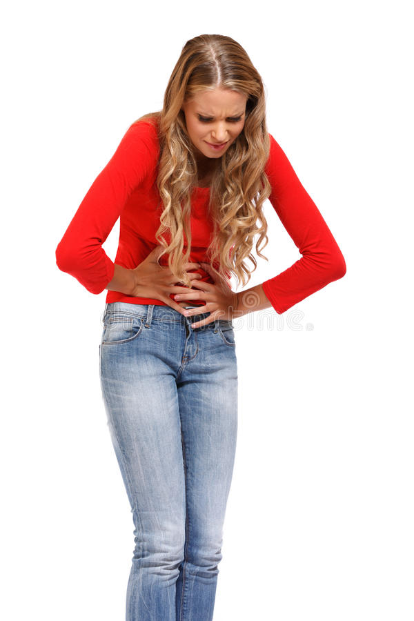 Młoda kobieta ma okropnego ból w żołądku zdjęcia royalty free