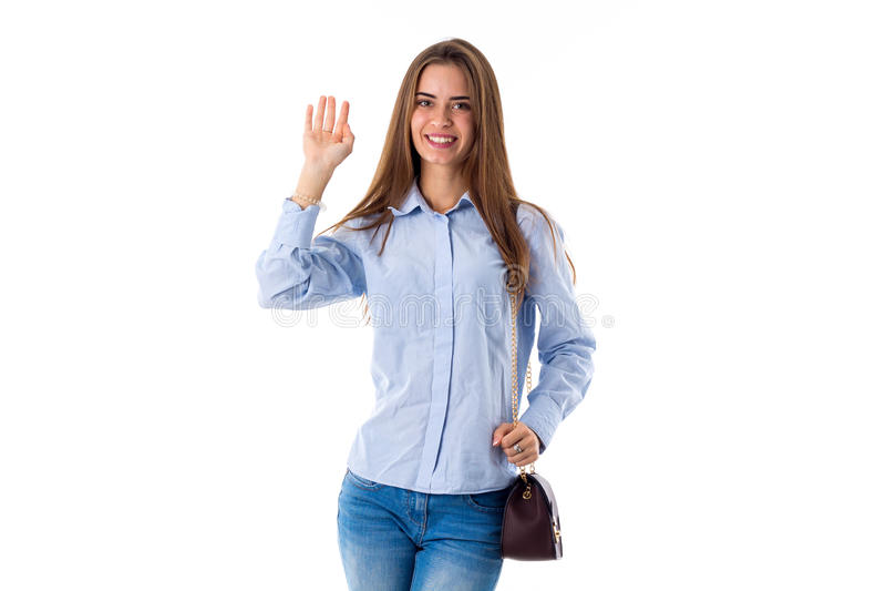 Młoda kobieta macha jej rękę zdjęcia stock